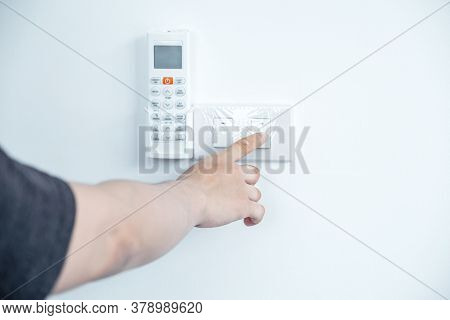 Hand Press Turn Off The Home Light Switch Concept Of Environmental Preservation And Energy Saving.