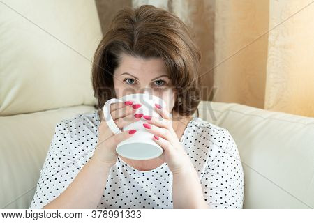 The Woman Drinking From A White Cup