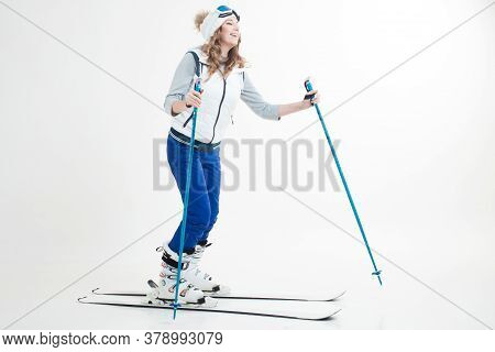 Skier Maneuvers On Mountain Skis, Photos On A White Background In The Studio, Winter Sports, Hobbies