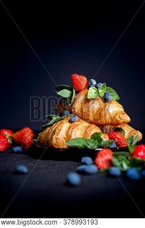 Croissants On A Dark Background. Croissant With Berries. French Breakfast With Croissants.  Close Up