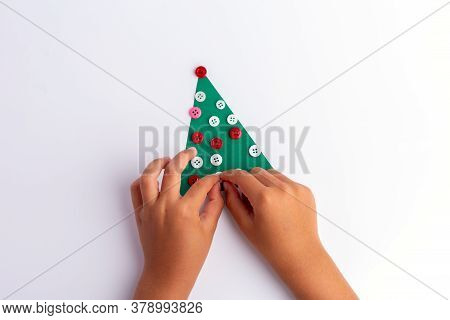 Christmas Craft For Kids. Diy, Hands Making Easy Paper Holiday Tree, Top View, Holiday Art. Christma