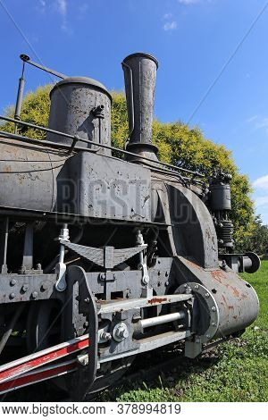 Old Locomotive Next To The Railway Station