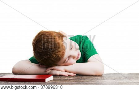 A Boy Sleeps Next To A Red Book, A Portrait Of A Child Who Is Learning On His Own