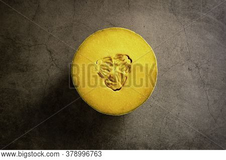 Fresh Cantaloupe On A Brown Cement Textured Background