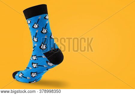Volumetric Blue Sock With Guitar Prints, Walking Sock, On A Yellow Background