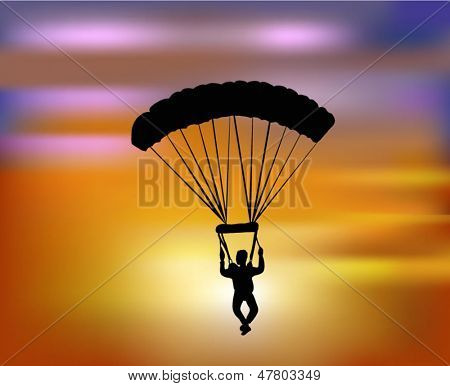 flying with the parachute in the sunset