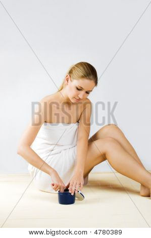 Woman Is Applying Some Creme At Her Skin