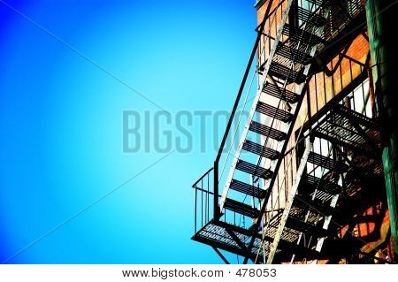 Fire Escape Stairs Against Blue Sky