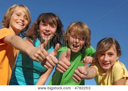 group ofpositive happy smiling tweens kids or children with thumbs up poster
