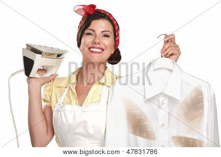 Happy Beautiful Woman Housewife Ironing A Shirt
