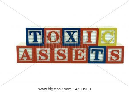 Wooden Alphabet Blocks Spelling Toxic Assets