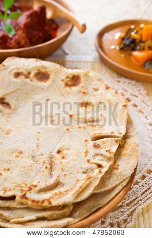 Chapati or Flat bread, Indian food, made from wheat flour dough. Chapatti,  Dhal and curry.