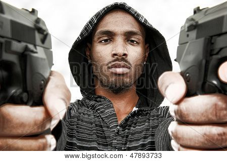 Angry Young Black Adult Male with Handguns