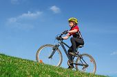 child kid youth cyclist or boy cycling on bicycle with safety helmet poster