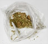 Medical Marijuana aka Pot, Dope, Mary Jane, Joint, Spliff, Ganja, Weed, 420, Herb, Medicine, Hash, Hemp, Bud and many other terms. In a clear plastic sandwich bag with a Joint rolled by hand poster