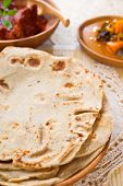 Chapati or Flat bread, Indian food, made from wheat flour dough. Chapatti,  Dhal and curry. poster
