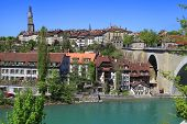 Cityscape of Bern Switzerland with arch bridge and old historic houses beside the Aare River poster