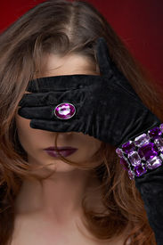 Young Beautiful Woman With Violet Jewelry