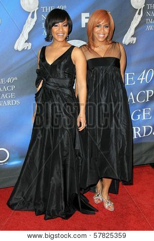 Tina Evette Atkins and Erica Monique Atkins at the 40th NAACP Image Awards. Shrine Auditorium, Los Angeles, CA. 02-12-09