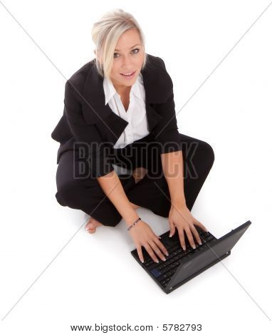 Beautiful Businesswoman Uses Her Netbook Wirelessly on white