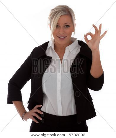 Beautiful Businesswoman Gives The Okay Sign isolated on white