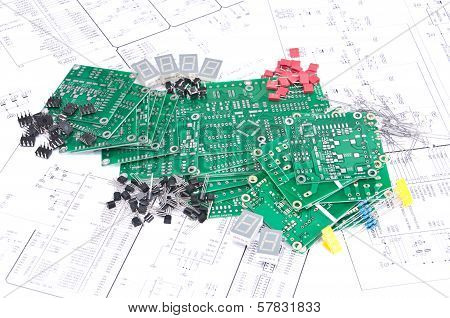 Circuit Boards And Components With Schematics In Background