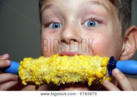 Child Eating Corn On The Cob