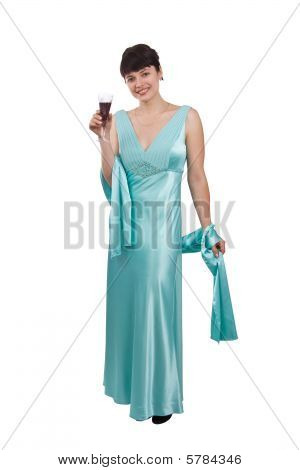 Woman proposes a toast to smb's health. Girl in greenness of the sea dress is standing and holding wine glass. Isolated on white background. poster