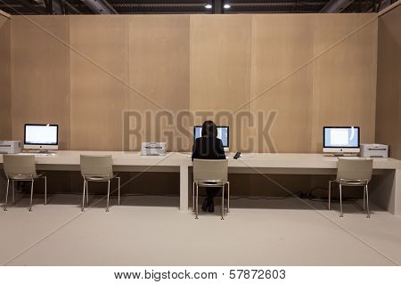 Girl Working At Computer At Homi, Home International Show In Milan, Italy