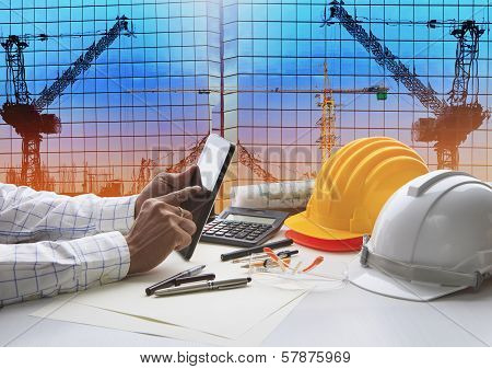Hand Of Architect Working On Table With Tablet Computer And Working Tool Equipment Against Reflectio