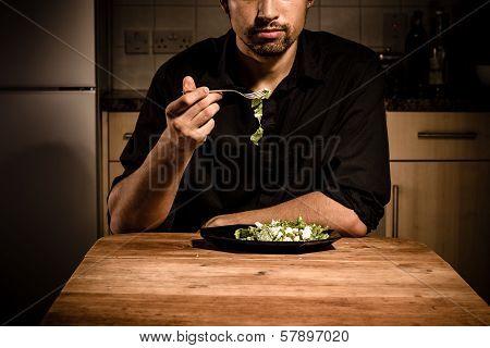 Young Bachelor Eating His Dinner