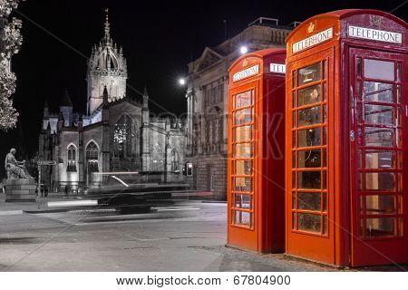 Classic red British telephone box, night scene