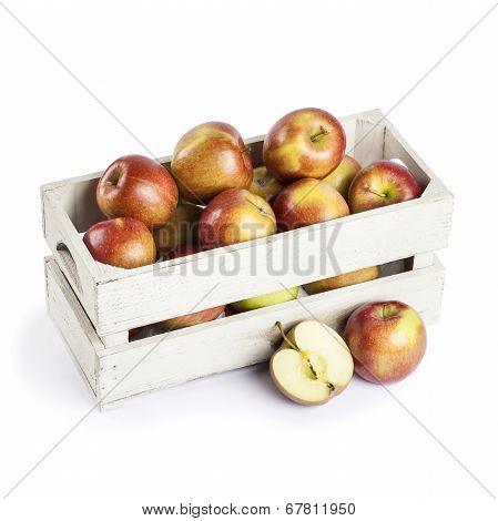 wooden box of apples on white background