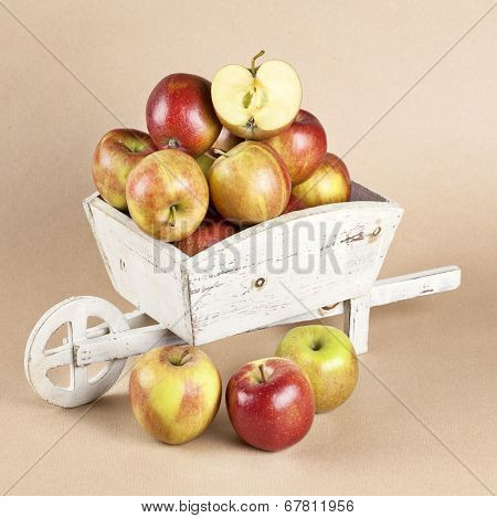 Fresh Apples In A Wooden Wheelbarrow