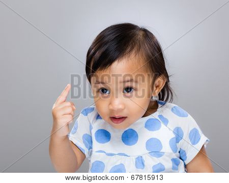 Baby girl frighten with finger