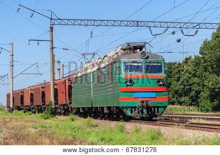 Electric locomotive hauling a grain train in Ukraine poster