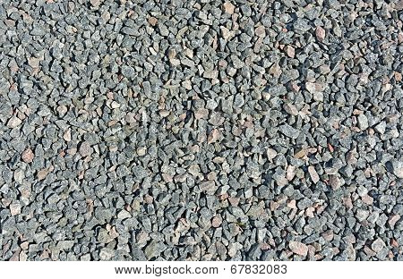 Crushed gravel texture. Natural light bright sunlight. poster