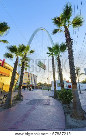 The Millennial Arch (Arco y Reloj Monumental) a metallic steel arch at the entrance of the city of Tijuana in Mexico at zona centro a symbol of union and vigor to the new millennium and a landmark that welcomes tourists in Avenida de revolucion with a sig poster
