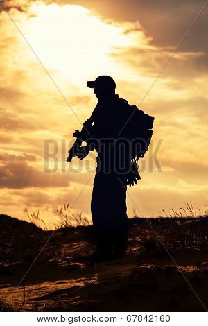 private military contractor with rifle against the sun poster