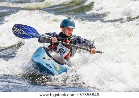Working the waves on the kayak