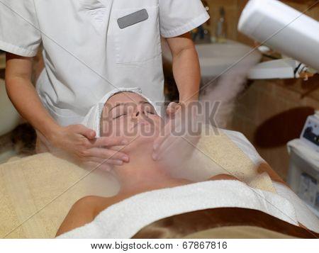 Beautiful Woman Receiving Facial Treatment At A Spa