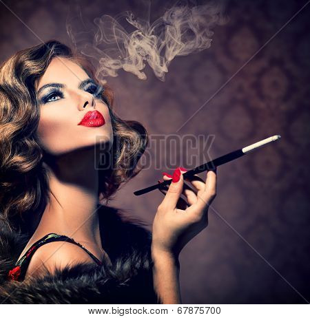 Beauty Retro Woman with Mouthpiece. Vintage Styled Beautiful Lady with cigarette. Smoking Model Girl Portrait. Hairstyle and Make up. Old Fashioned Makeup and Finger Wave Hairstyle. 20's or 30's style