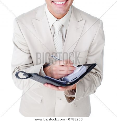 Close-up Of A Businessman Making Notes On His Diary