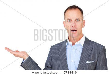 Surprised Businessman Showing A Copyspace