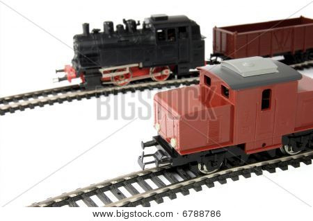 Toy Diesel Locomotive and Steam Train with freight wagon