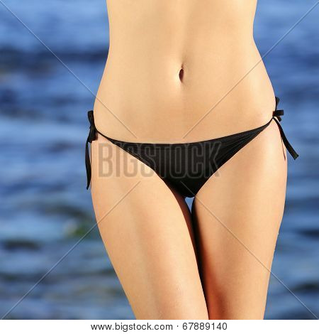 Front View Of A Woman Perfect Hips Wearing Bikini On The Beach