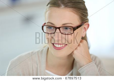 Beautiful smiling woman with eyeglasses on