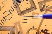 RFID implantation syringe and chips on RFID tags, orange background poster