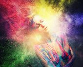 Woman muse with creative body art and hairdo in colourful powder explosion   poster