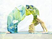 Double exposure portrait of young woman performing back bend combined with photograph of nature poster